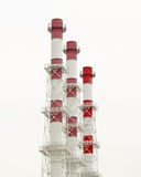 Three red and white tubes. And cloudy sky Stock Images