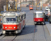 Three red and white vintage tram and people Stock Photo