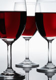 Three red wine glasses Stock Photo
