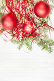 Three red Xmas baubles and twig on blank paper Royalty Free Stock Images