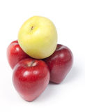 Three red and yellow apples in a pyramid Stock Photo