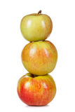 Three red-yellow apples on white background Stock Photography