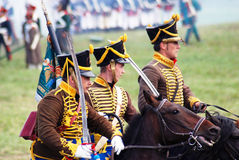 Three reenactors ride horses. Profile portrait. Stock Photography