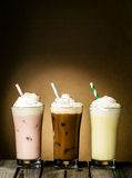 Three refreshing creamy milkshakes Stock Photos