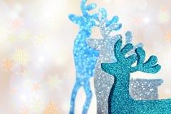 Three reindeer figurines on winter background Stock Photo