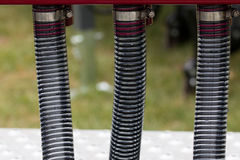 Three reinforced pipes on an agricultaral machine Royalty Free Stock Photo