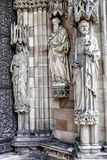 Three religious statues on a church wall Royalty Free Stock Photography