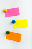 Three empty reminder notes on a white background. Three reminder notes, one yellow, one pink, one orange on a white background Stock Images