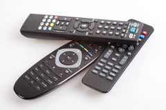 Three remote control devices. On white background royalty free stock images