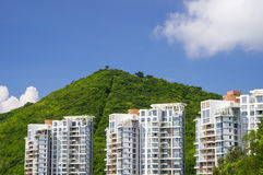 Three residential buildings against a mountain Stock Photos