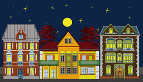 Three residential houses. Three historical buildings in a row at night; very elaborate and highly detailed Royalty Free Stock Image