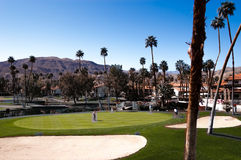 Golfers relax on a spectacular golf course in Palm Springs Royalty Free Stock Photography