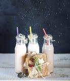 Three retro bottles with milk cocktail   and slice toast bread Stock Photos