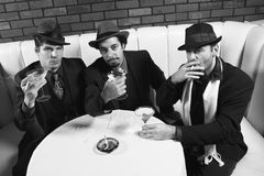 Three retro businessmen. Royalty Free Stock Photography