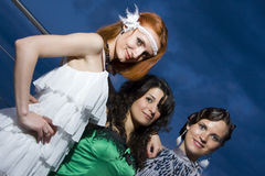 Three retro girlfriends in the evening Royalty Free Stock Image