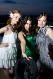 Three retro girlfriends in the evening Royalty Free Stock Photography