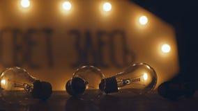 Three retro incandescent bulbs. Old vintage light bulb. Set of vintage glowing light bulbs on black. light bulbs in the dark. old style Incandescent bulbs Stock Photos