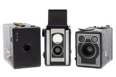 Three retro photo cameras on a row Stock Images