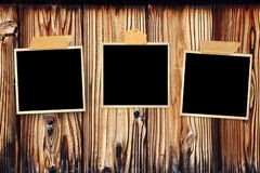 Three retro photos on old wooden wall. Mock up template. Copy space for your text stock image