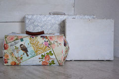 Three retro suitcases on a white wooden background. Vintage style Royalty Free Stock Photo