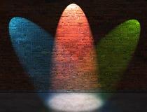 Three RGB spot lights. On old brick wall Royalty Free Stock Photography
