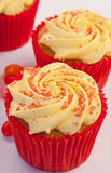 Three rhubarb cupcakes with jelly beans Royalty Free Stock Images