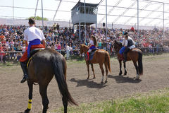 Three riders in national Ukrainian costumes ride horses Royalty Free Stock Images