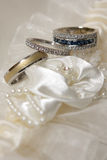 Three Rings. Three diamond wedding rings on material flowers Stock Photos