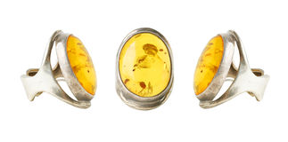 Three rings with amber, a collage Royalty Free Stock Image