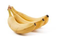 Three ripe bananas. Three ripe yellow  bananas on white background Royalty Free Stock Photos