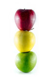 Three ripe colorful apples stacked as a trafficlight Stock Images