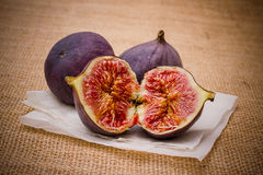 Three ripe figs on baking paper background Royalty Free Stock Images