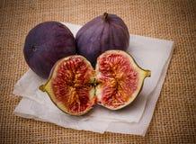 Three ripe figs on baking paper background Stock Photo