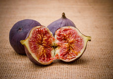 Three ripe figs from jute background Royalty Free Stock Image