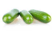 Three Ripe Green Cucumbers Isolated on White Stock Photo