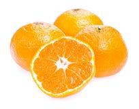 Three ripe juicy Tangerine and half  Royalty Free Stock Photo