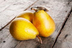 Three ripe juicy yellow pears Royalty Free Stock Photo