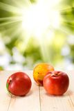 Three ripe nectarine against the sun closeup Stock Photo