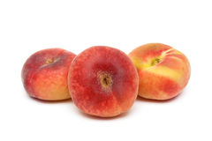 Three ripe peach close-up on a white background Stock Photography