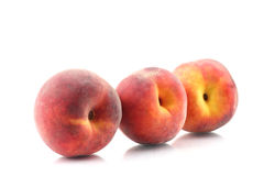 Three ripe peach on a white background Royalty Free Stock Photography