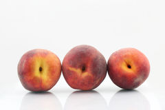 Three ripe peach on a white background Royalty Free Stock Images