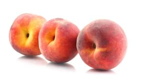 Three ripe peach on a white background. Useful vitamin food of fruit stock photos