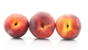 Three ripe peach on a white background. Useful vitamin food of fruit royalty free stock photos