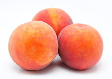 Three ripe peaches isolated Stock Image