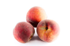 Three ripe peaches isolated on white background Stock Images