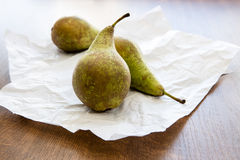 Three ripe pears on crumpled card Royalty Free Stock Photos
