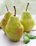 Three ripe pears on the table Royalty Free Stock Images