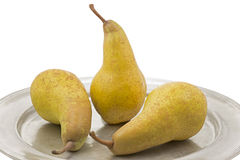 Three ripe pears on a tin plate Stock Photography