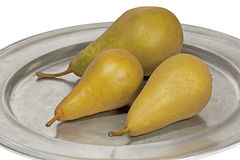 Three ripe pears on a tin plate Stock Photo