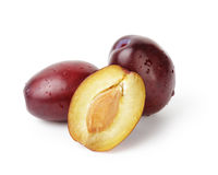 Three ripe plums Stock Images
